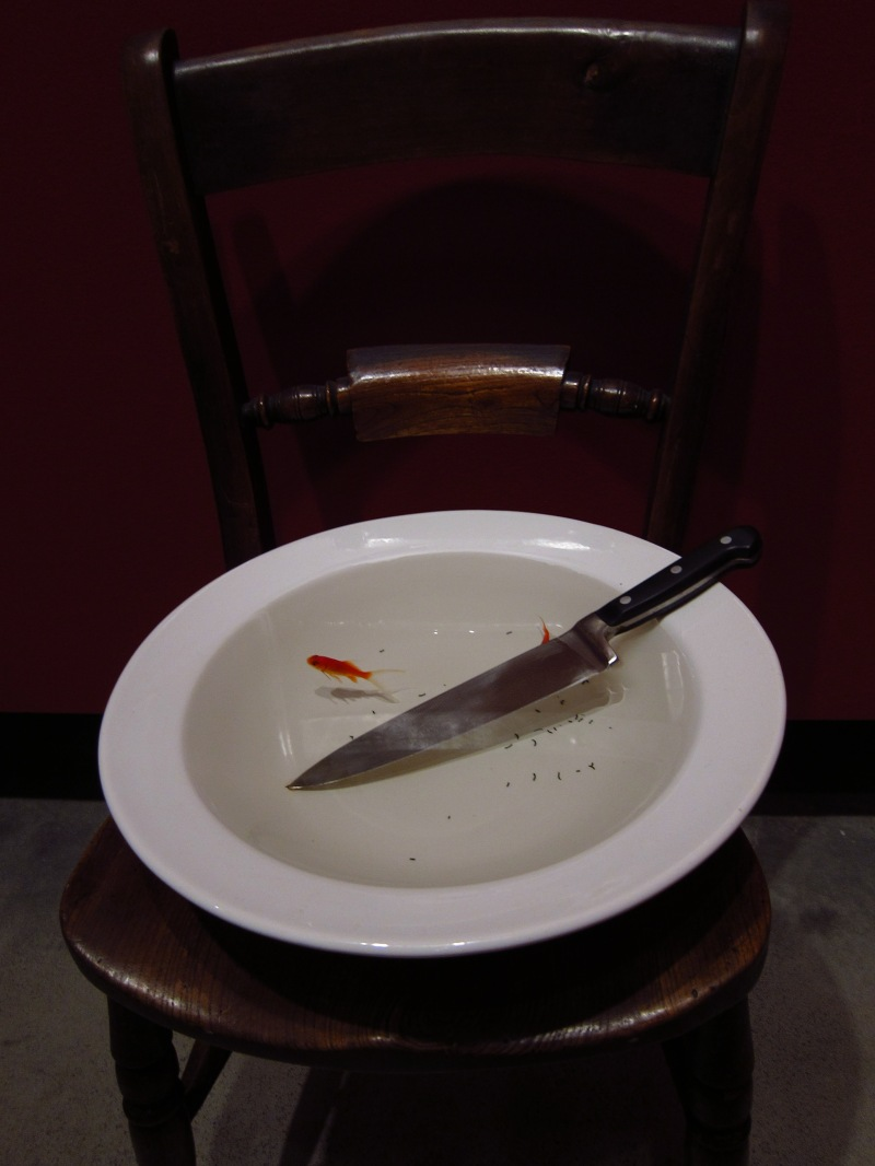 fish in bowl with knife
