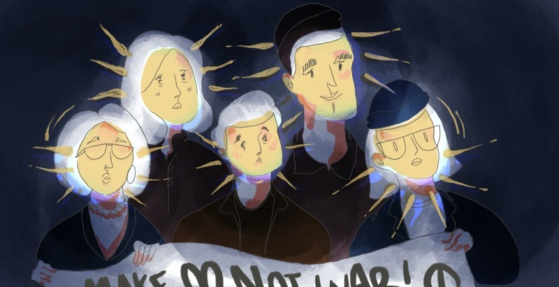 Illustration of a person with a bob, spectacles & a beanie standing in the dark, though their face is aglow. They are holding a banner together with a crowd of others.